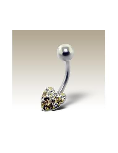 Piercing nombril avec coeur de cristal.